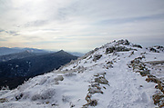 Snow covered scree walls along the Appalachian Trail (Franconia Ridge Trail) in the White Mountains of New Hampshire during the winter months. Scree walls are built on the edge of trails to discourage hikers from going off trail. Building these small walls helps protect the fragile alpine habitat.