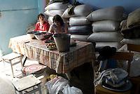 REPUBLIC OF MOLDOVA, Gagauzia, Vulcanesti, 2009/06/30..Viera and her sister Anna Ageder Mikhailovna  prepare canned sour cherries in the summer kitchen, where reserves are stored wheat for the year. They meet for the summer in the family home. Viera lives in Moscow. Anna wants to go back to Turkey despite her time in jail for illegal stay in Istanbul..© Bruno Cogez / Est&Ost Photography..REPUBLIQUE MOLDAVE, Gagaouzie, Vulcanesti, 30/06/2009..Viera et sa soeur Anna Ageder Michailovna préparent des conserves de cerises aigres dans la cuisine d'été où sont entreposées les réserves de blé pour l'année. Elles se retrouvent pour l'été dans la maison familiale. Viera vit à Moscou. Anna veut retourner en Turquie malgré son passage en prison pour séjour illégal à Istanbul..© Bruno Cogez / Est&Ost Photography