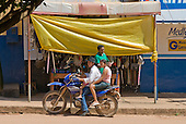 Pará State, Brazil. São Félix do Xingu. Family transport; three on a motorbike.