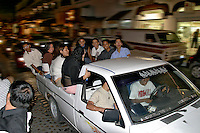 It's Saturday night and Mexican teens cruise The Malacon (downtown) in Puerto Vallarta, Mexico. This is a popular choice of vehicle for going out with friends.