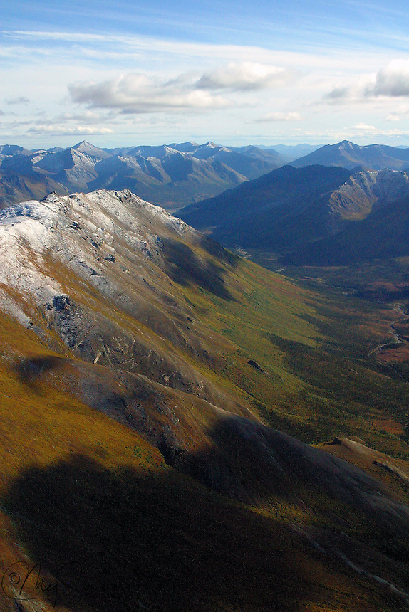 Fall comes early to the Arctic. By September 1 the tundra is in full turn and brilliant in its breadth and variety. This portion of the Brooks Range is within the Gates of the Arctic National Park, Alaska.