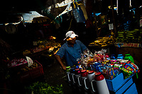 A Colombian street vendor pushes a cart, loaded with thermos filled with coffee and sweeties, in the market of Bazurto in Cartagena, Colombia, 6 December 2018. Far from the touristy places in the walled city, a colorful, vibrant labyrinth of Cartagena's biggest open-air market sprawls to the Caribbean seashore. Here, in the dark and narrow alleys, full of scrappy stalls selling fruit, vegetables and herbs, meat and raw fish, with smelly garbage on the floor and loud reggaeton music in the air, the African roots of Colombia are manifested.