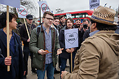 An Iraqi man argues with supporters of detained Austrian far-right leader Martin Sellner at a protest at Speakers' Corner, London, where he had been scheduled to speak.