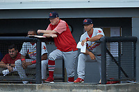(L-R) Johnson City Cardinals pitching coach Rick Harig (21) and mamager Roberto Espinoza (41) watch from the dugout during the game against the Burlington Royals at Burlington Athletic Stadium on September 4, 2019 in Burlington, North Carolina. The Cardinals defeated the Royals 8-6 to win the 2019 Appalachian League Championship. (Brian Westerholt/Four Seam Images)