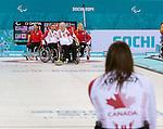 Jim Armstrong, Sochi 2014 - Wheelchair Curling // Curling en fauteuil roulant.<br /> Canada competes against USA in Wheelchair Curling round robin play // Le Canada affronte les États-Unis dans le tournoi à la ronde de curling en fauteuil roulant. 10/03/2014.