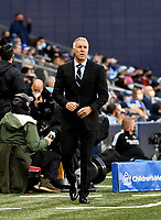 KANSAS CITY, KS - APRIL 23: Sporting Kansas City manager Peter Vermes walks up and down the sideline during a game between Orlando City SC and Sporting Kansas City at Children's Mercy Park on April 23, 2021 in Kansas City, Kansas.
