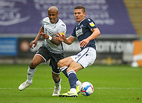 3rd October 2020; Liberty Stadium, Swansea, Glamorgan, Wales; English Football League Championship, Swansea City versus Millwall; Andre Ayew of Swansea City and Shaun Hutchinson of Millwall jostles for possession
