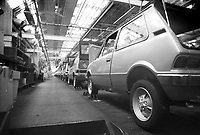 - assembly lines stopped in Innocenti Leyland car factory at Lambrate, occupied by workers for protest against dismissal (Milan, 1975); unsold cars parked on yards....- catene di montaggio ferme nella fabbrica di automobili Innocenti Leyland di Lambrate ocupata dagli operai  per protesta contro i licenziamenti  (Milano, 1975)