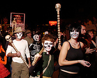 Participants walk in the All Souls' Procession on North Fourth Avenue Sunday night. About 3000 people took park in the procession.