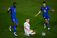 April 27th 2021; Alfredo Di Stefano Stadium, Madrid, Spain;  UEFA Champions League. Toni Kroos Real Madrid taken down by Christian Pulisic and Antonio Rudiger of Chelsea FC during the Champions League match, semifinals between Real Madrid and Chelsea FC played at Alfredo Di Stefano Stadium