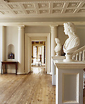 View of the Hallway of the C18th Staircase Hall created by John Chute, at The Vyne, showing ceiling mouldings, pillars, busts and floorboards.