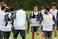 14th September 2021: The  AXA Training Centre, Kirkby, Knowsley, Merseyside, England: Liverpool FC training ahead of Champions League game versus AC Milan on 15th September: Mohammed Salah of Liverpool  smiles as he warms up with his team mates