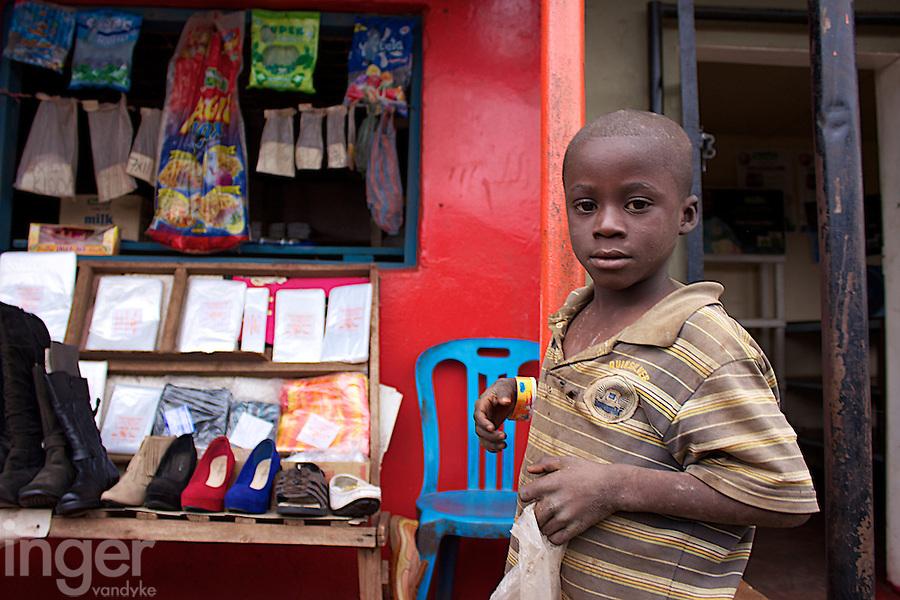 Stall holder's child in Dambwa Central Market, Livingstone, Zambia