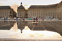 Place de la Bourse. The new fountain Miroir d'Eau, Water Mirror, making reflections. Bordeaux city, Aquitaine, Gironde, France