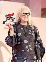 """VENICE, ITALY - SEPTEMBER 11: Director Jane Campion poses with the Silver Lion for Best Director for """"The Power Of The Dog"""" at the awards winner photocall attends the awards winner photocall during the 78th Venice International Film Festival on September 11, 2021 in Venice, Italy."""