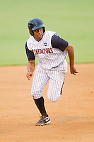 Jordan Cheatham #32 of the Kannapolis Intimidators takes off for third base against the Hickory Crawdads at Fieldcrest Cannon Stadium August 17, 2010, in Kannapolis, North Carolina.  Photo by Brian Westerholt / Four Seam Images