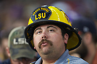 a LSU Tigers fan wears a custom fire helmet as he cheers for his team during the game against the Baylor Bears in game five of the 2020 Shriners Hospitals for Children College Classic at Minute Maid Park on February 29, 2020 in Houston, Texas. The Bears defeated the Tigers 6-4. (Brian Westerholt/Four Seam Images)