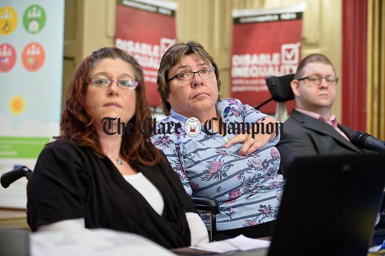 Leigh Gath, campaigner for people with disabilities,  flanked by Anne Marie Flanagan  and Padraic Hayes  at a Clare Leader Forum public meeting for people with disabilities, with election candidates in the Temple Gate Hotel. Photograph by John Kelly.