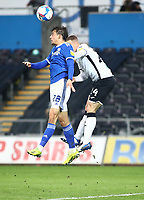 20th March 2021; Liberty Stadium, Swansea, Glamorgan, Wales; English Football League Championship Football, Swansea City versus Cardiff City; Tom Sang of Cardiff City jumps to head the ball in front of Jake Bidwell of Swansea City