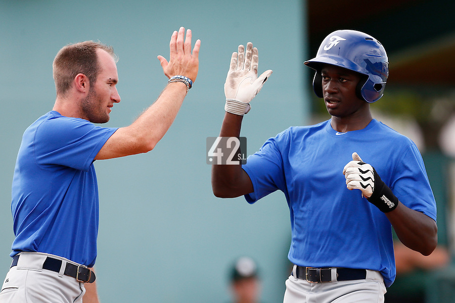 19 September 2012: Frederic Hanvi is congratulated by Joris Bert after hitting a home run during Team France friendly game won 6-3 against Palm Beach State College, during the 2012 World Baseball Classic Qualifier round, in Lake Worth, Florida, USA.