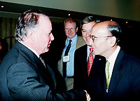 Montreal, June 1st 1999 File Photo<br /> (New caption Feb 12, 2001) Parti Quebecois leadership Candidate and most likely to suceed to Lucien Bouchard as Quebec Premier, Bernard Landry (then Quebec Minister of Finances and Vice Premier) ;  the Honorable Bernard Landry (left) shake hands with New York Stock Exchanges CEO and Chairman;  Richard Grasso (right) before Mr Grasso speech at the 5th `` Conference of Montreal `` on economy globalization on June 1st, 1999 in Montreal (Quebec, Canada)<br /> <br /> Photo by Pierre Roussel