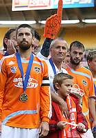Houston captain Wade Barrett, coach Dominic kinnear and Ryan Cochrane await the trophy presentation. The Houston Dynamo defeated the New England Revolution 2-1 in the finals of the MLS Cup at RFK Memorial Stadium in Washington, D. C., on November 18, 2007.