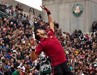 Paris, France, 03 June, 2016, Tennis, Roland Garros, Semifinal men, Novak Djokovic (SRB) serves in his match against Dominic Thiem (AUT)<br /> Photo: Henk Koster/tennisimages.com