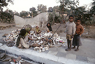 January 1979, New Delhi, India. In the outskirts of New Delhi, children are employed for the sorting of trash. - Child labor as seen around the world between 1979 and 1980 - Photographer Jean Pierre Laffont, touched by the suffering of child workers, chronicled their plight in 12 countries over the course of one year.  Laffont was awarded The World Press Award and Madeline Ross Award among many others for his work.
