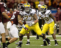 Taylor Lewan of Michigan in action during Sugar Bowl game against Virginia Tech at Mercedes-Benz SuperDome in New Orleans, Louisiana on January 3rd, 2012.  Michigan defeated Virginia Tech, 23-20 in first overtime.