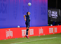 LAKE BUENA VISTA, FL - JULY 26: Luis Martins of Sporting KC heads the ball during a game between Vancouver Whitecaps and Sporting Kansas City at ESPN Wide World of Sports on July 26, 2020 in Lake Buena Vista, Florida.