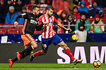 Diego Costa of Atletico de Madrid (R) fights for the ball with Ruben Miguel Nunes Vezo of Valencia CF (L) during the La Liga 2017-18 match between Atletico de Madrid and Valencia CF at Wanda Metropolitano on February 04 2018 in Madrid, Spain. Photo by Diego Souto / Power Sport Images
