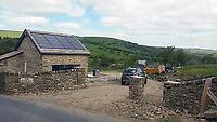 BNPS.co.uk (01202 558833)<br /> Pic: BNPS<br /> <br /> The Rookery during construction<br /> <br /> A resourceful couple have made a £150,000 profit after knocking down a derelict old farm building and constructing an impressive eco-friendly retreat in its place.<br /> <br /> Art technician Danielle Coates, 33, and her husband Ben, 33, a carpenter, have created The Rookery, in the scenic village of Roughlee, East Lancs.<br /> <br /> They spent £200,000 buying six acres of farmland and building the two bedroom detached stone home. It has been a shrewd investment as the property, which was completed in 2015, is now valued at £350,000.<br /> <br /> They are currently renting out the two bedroom cottage as a holiday let on cottages.com, with it generating an annual turnover of £50,000.<br /> <br /> Original stones from the demolished farm building have been incorporated into the new structure. Solar panels have been fitted to generate enough energy to run the entire house, and recycled timber from the farm used to fashion shelves and handles.
