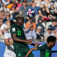 GRENOBLE, FRANCE - JUNE 22: Lena Oberdorf #6, Uchenna Kanu #12 battle for head ball during a game between Nigeria and Germany at Stade des Alpes on June 22, 2019 in Grenoble, France.