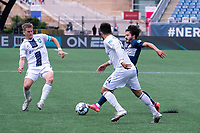 FOXBOROUGH, MA - JULY 4: Aaron Walker #8 of Greenville Triumph SC comes in to tackle Ryan Spaulding #34 of the New England Revolution II during a game between Greenville Triumph SC and New England Revolution II at Gillette Stadium on July 4, 2021 in Foxborough, Massachusetts.
