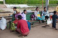 Myanmar, Burma.  Passengers Waiting on the Platform at Kalaw Train Station.