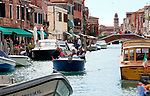 Boats are the main mode of transportation around Venice as they navigate the waterways surrounded by beautiful historic architecture.