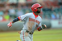 Harrisburg Senators outfielder Brian Goodwin #23 runs to first on a double during a game against the Erie Seawolves on July 2, 2013 at Jerry Uht Park in Erie, Pennsylvania.  Erie defeated Harrisburg 2-1.  (Mike Janes/Four Seam Images)