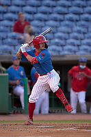 Clearwater Threshers Carlos De La Cruz (6) bats during a game against the Dunedin Blue Jays on May 18, 2021 at BayCare Ballpark in Clearwater, Florida.  (Mike Janes/Four Seam Images)