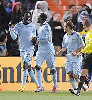 Sporting Kansas City forward C.J. Sapong (17) celebrates with teammate Kei Kamarta (23) his score in the 90th of the game. Sporting Kansas City defeated D.C. United  1-0 at RFK Stadium, Saturday March 10, 2012.