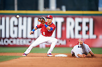 Buffalo Bisons second baseman Andy Burns (8) waits for a throw as Juan Perez (4) slides into second during a game against the Louisville Bats on June 20, 2016 at Coca-Cola Field in Buffalo, New York.  Louisville defeated Buffalo 4-1.  (Mike Janes/Four Seam Images)