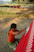 Traditional production of Silk and Cotton near the U-Bein Bridge, Amarapura, Mandalay, Myanmar, Burma