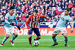 Angel Correa of Atletico de Madrid (C) fights for the ball with Facundo Roncaglia of RC Celta de Vigo (L) and Jonathan Castro Otto, Jonny, of RC Celta de Vigo (R) during the La Liga 2017-18 match between Atletico de Madrid and RC Celta de Vigo at Wanda Metropolitano on March 11 2018 in Madrid, Spain. Photo by Diego Souto / Power Sport Images