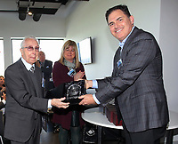 Pictured: Jason Levien (R) gives an award Tuesday 04 April 2017<br /> Re: Official opening of the Fairwood Training Complex of Swansea City FC, Wales, UK