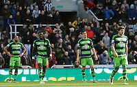 Swansea City look on dejected after conceding a goal during the Barclays Premier League match between Newcastle United and Swansea City played at St. James' Park, Newcastle upon Tyne, on the 16th April 2016
