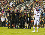 Virginia Tech defensive back Bryce Watts (5) watches as the Florida State offense huddles in the 2nd half of an NCAA college football game in Tallahassee, Fla., Monday, Sept. 3, 2018. Virginia Tech defeated Florida State 24-3.  (AP Photo/Mark Wallheiser)