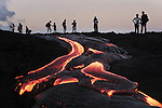 HAWAII  -  AUGUST 07, 2003:  Tourists watch lava flows from the Puu Oo vent the Hawaii Volcanoes National Park southwest of Hilo on the Big Island of Hawaii on August 7th, 2003. (PHOTOGRAPH BY MICHAEL NAGLE)