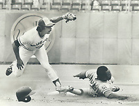 1979 FILE PHOTO - ARCHIVES -<br /> <br /> Putting his feet to work, Blue Jays' second baseman Dave McKay catches Al Oliver stealing during yesterday's game at Exhibition Stadium. McKay used his foot to block Oliver's path to second base and then applied the tag following a perfect throw from catcher Rick Cerone.<br /> <br /> <br /> Bezant, Graham<br /> Picture, 1979<br /> <br /> 1979,<br /> <br /> PHOTO : Graham Bezant - Toronto Star Archives - AQP