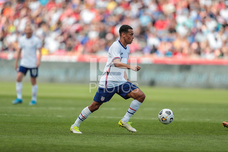 SANDY, UT - JUNE 10: Tyler Adams #4 of the United States looks for an open man downfield during a game between Costa Rica and USMNT at Rio Tinto Stadium on June 10, 2021 in Sandy, Utah.