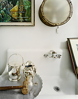 Silver simplicity in the water closet of a Victorian New Orleans home
