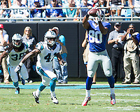 The Carolina Panthers played the New York Giants at Bank of America Stadium in Charlotte, NC.  The Panthers won 38-0 for their first victory of the season.  The Giants dropped to 0-3.  New York Giants wide receiver Victor Cruz (80), Carolina Panthers cornerback Captain Munnerlyn (41)